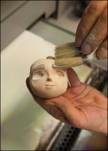 Puppet faces being removed from machine
